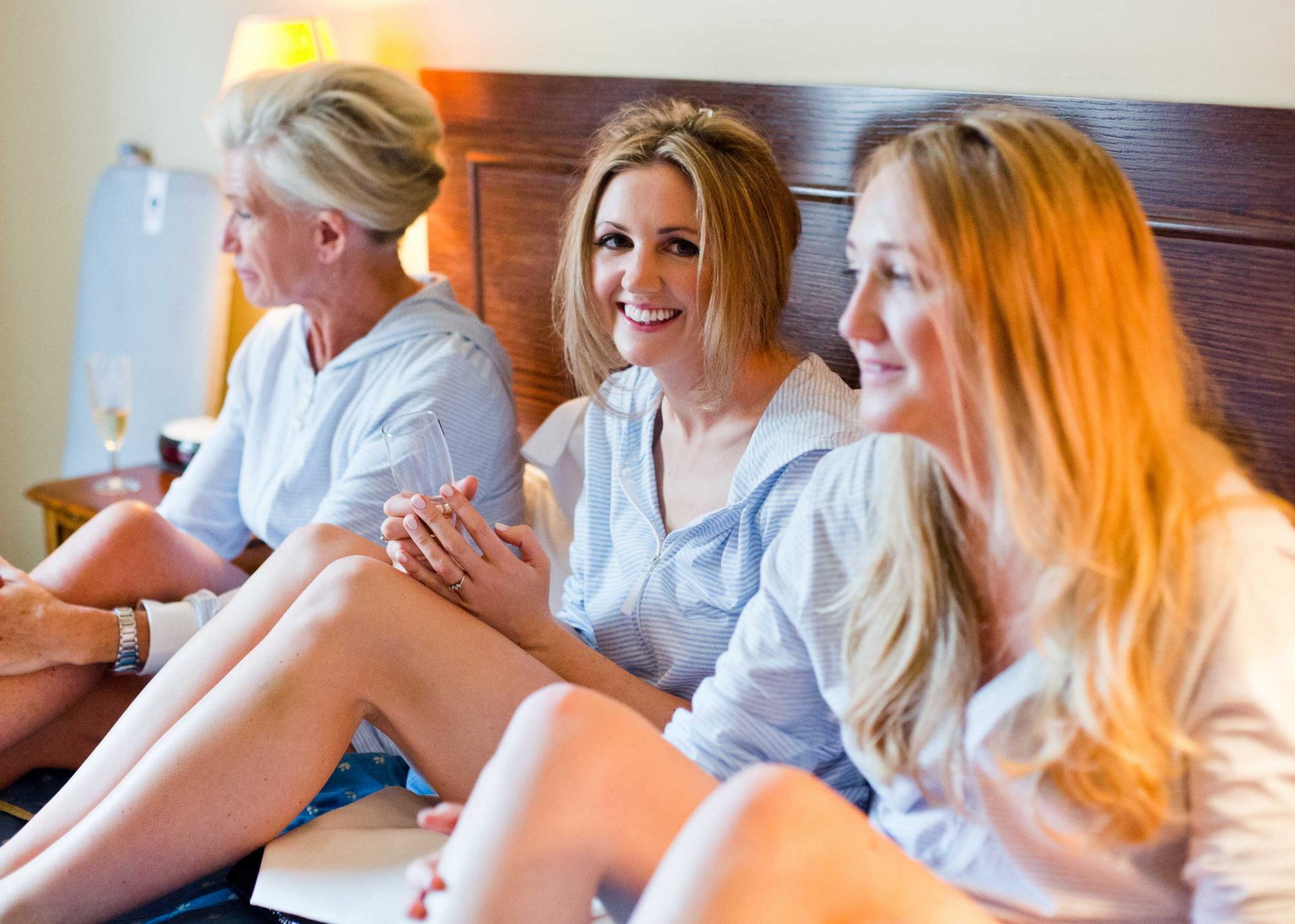 Bride and bridesmaids in pyjamas in bed