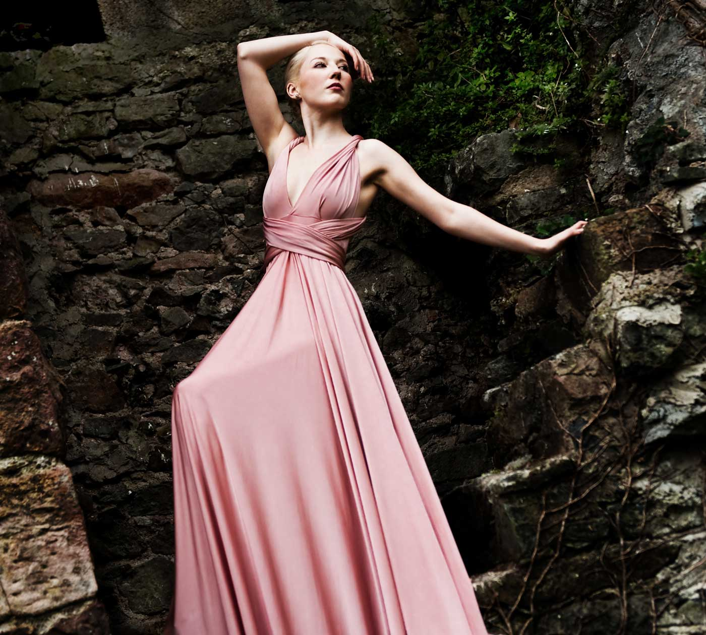 Model in pink maxi bridesmaid dress
