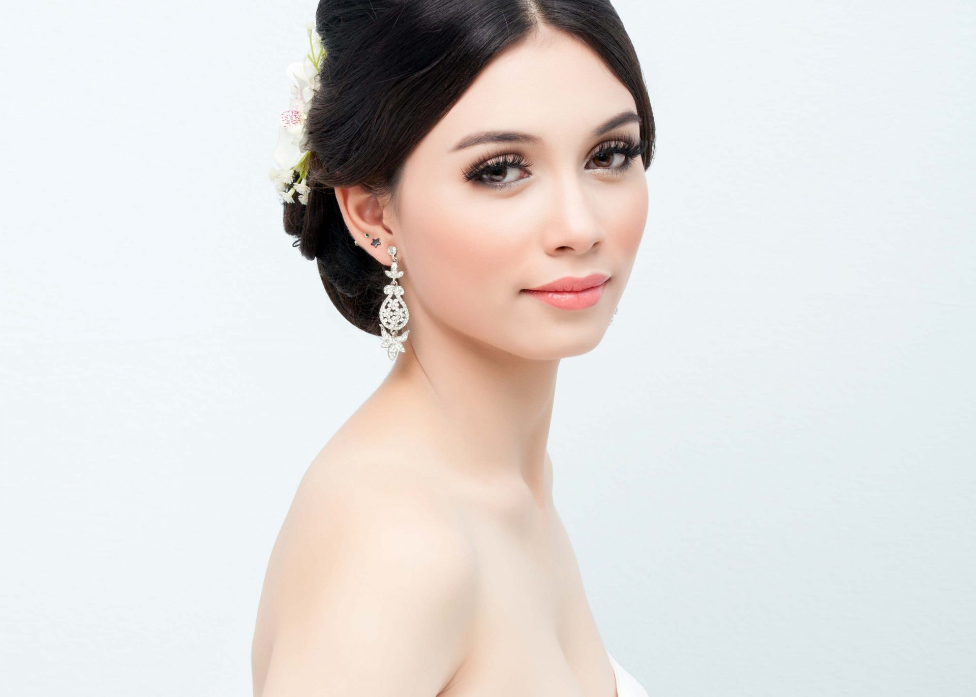 bride hair up sparkly earrings